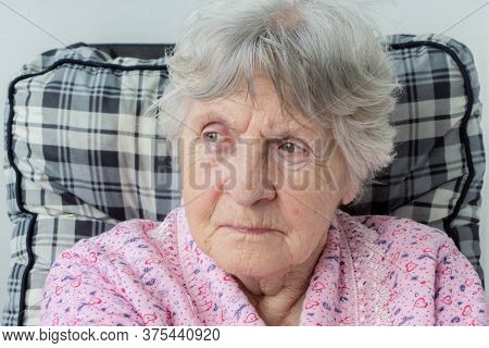 Portrait Of Old Senior Woman With Wrinkles On Face And Gray Hair. Eldery Lady With Wrinkled Face. Cl