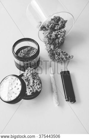 Joint Weed. Marijuana Nature Bud. The Pot Leaves On Buds. Cannabis Weed Bud And Grinder. Thc Cbd. Ye