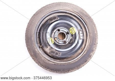 Full Size Spare Tire Of A Black Car Isolated On White Background In Photo Studio. Spare Summer Tire