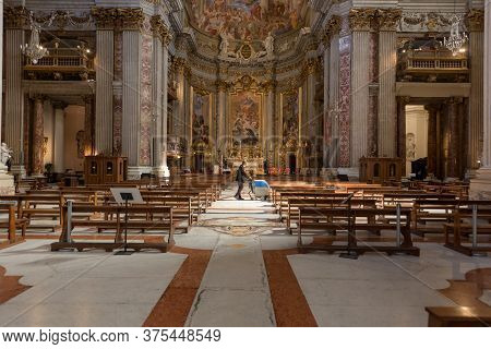 Rome, Italy - 19 May 2020: A Worker Polishes The Marble Floors Between Rows Of Benches In Saint Igna