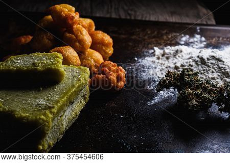 Churros Balls Spanish Donuts From Medical Cannabis Butter, Sugar, Flour, Egg. Nearby Are Marijuana B