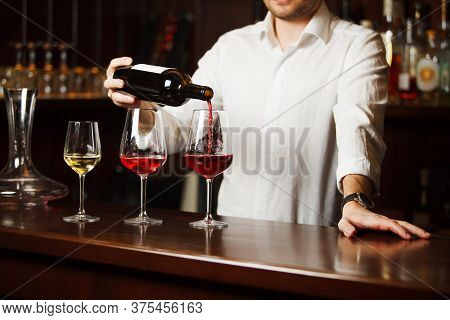 Sommelier Pouring Different Types Of Fine Wine