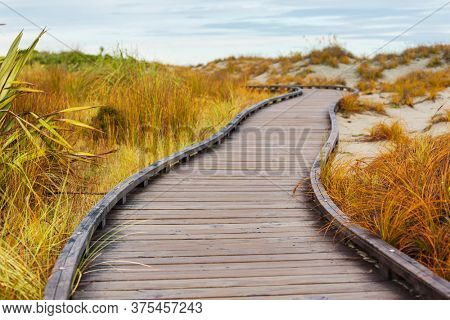 Wooden boardwalk on the tropical beach