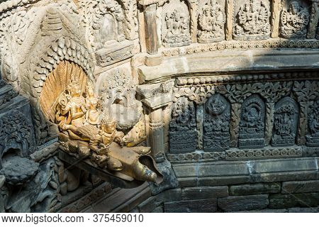 Patan, Nepal : October-16-2018 : The Golden Spout Of Sunken Water Tank (named Tusha Hiti) In Royal P