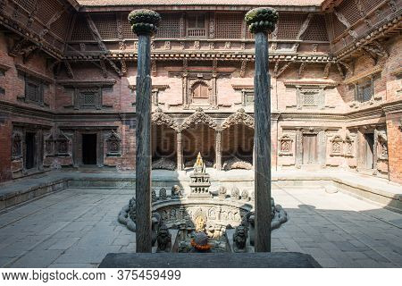 Patan, Nepal : October-16-2018 : The Holy Carved Sunken Water Tank (named Tusha Hiti) In Royal Palac