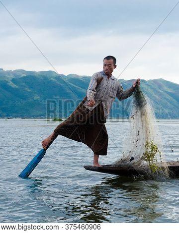 Paddling Fisherman In Inle Lake, Myanmar