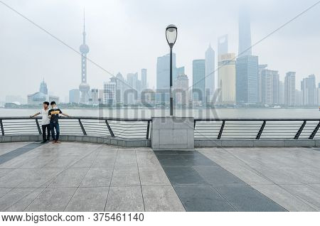 Shanghai, China - 6 Jun 2015: Two Young Men Pose For A Selfie Picture In Front Of Shanghai Business