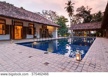Tangalle, Sri Lanka - 11 Feb 2016: A Swimming Pool Is Lit At Dusk In Maya Villa Boutique Hotel Patio