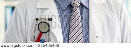 Male Medicine Therapeutist Doctor Chest With Stethoscope In Pocket Closeup. Medical Tools And Instru