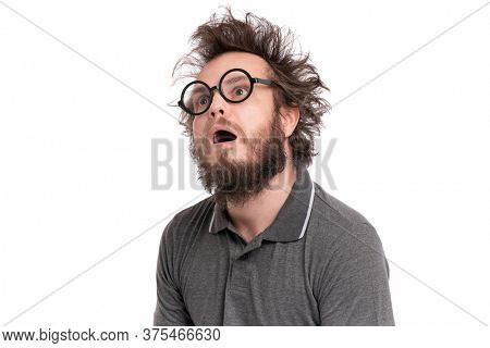 Crazy Scared or Shocked Bearded Man with funny Haircut in Eyeglasses looks Worried. Silly, Afraid or Surprised guy, isolated on white background.