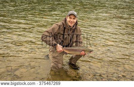 Kitimat, British Columbia, Canada - July 27th, 2015:a Fisherman Holding Up A Doe Sockeye Salmon At S