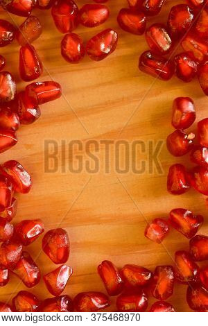 Red Ripe Pomegranate Seeds Close Up. Beautiful Background Texture Of The Seeds Of The Fruit Pomegran