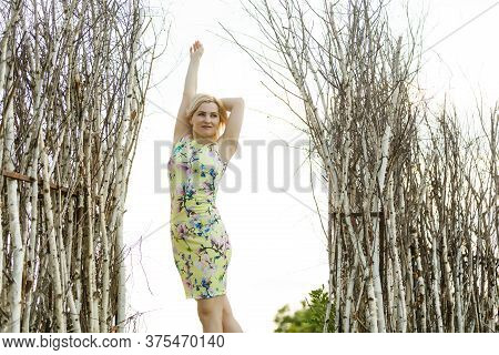 Pretty, Atractive Woman Standing In A Gazebo In A Park