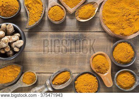 Turmeric Powder And Fresh Turmeric. Curcuma Longa