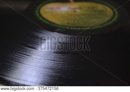 70\\\'s vinyl record\\nVinyl record from the 70s photographed in a cluseup - today considered a vintage collection item - closeup photo