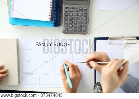 Family Income And Expenses Budget Planning. Man And Woman Make Family Budget Concept