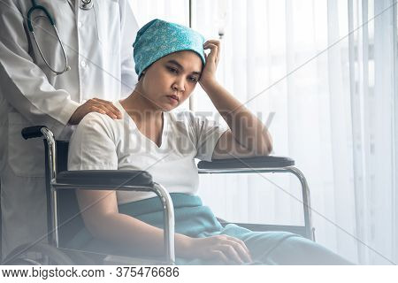 The Doctor's Hand Is Placed On The Shoulders Of A Female Patient Which Sat On Wheelchair To Encourag