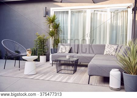 Outdoor Seating And Garden Furniture On Patio Of Contemporary Home