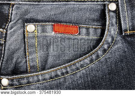Black Jeans Fabric With Side Pocket Background. Jeans Detail. Black Jeans Texture Background.