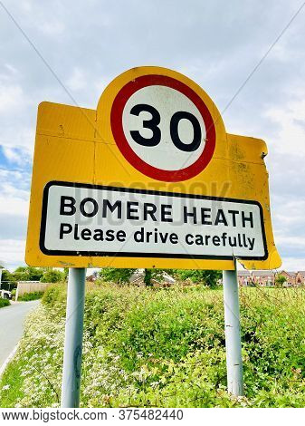 Road Sign Showing Bomere Heath In Shropshire With 30mph Speed Limit Into The Village
