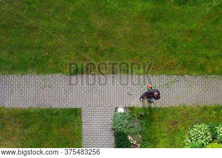 Ceske Budejovice,czech Republic - Jun 8,2020 - City Service Worker Cutting Grass On Big Mower
