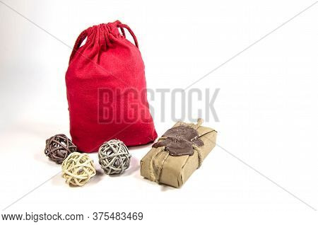 A Red Gift Pouch And A Small Package With A Wax Seal, Tied With Twine On White Background. Romantic