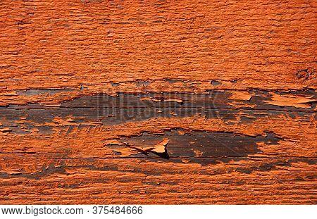 Orange Peeling Paint On Wood Rustic Texture.