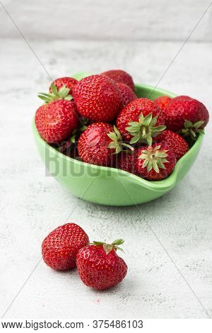 Fresh Strawberries In A Bowl On Marble White Table. Fresh Nice Strawberries. Strawberry Field On Fru