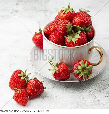 Fresh Strawberries In A White Cup On Marble White Table. Fresh Nice Strawberries. Strawberry Field O