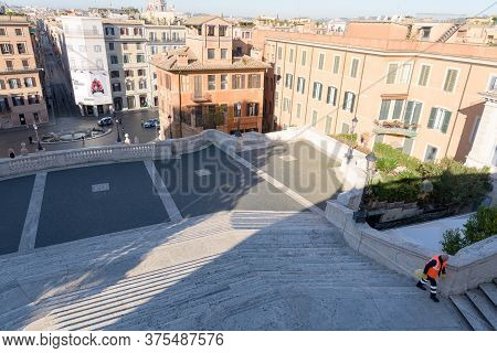 Rome, Italy - 12 March 2020: A Street Cleaner Climbs The Deserted Spanish Steps, A Rare Sight In Rom