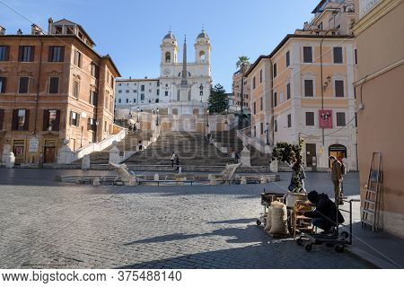 A Street Vendor Prepares Their Stand In Front Of The Deserted Spanish Steps