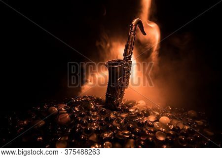 Alto Gold Sax Miniature With Colorful Toned Light On Foggy Background. Saxophone Music Instrument In