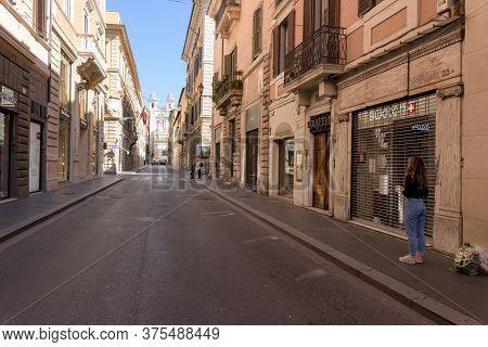 Woman Stands Alone In Via Dei Condotti, Rome, Italy