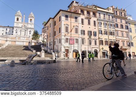Tourist Taking Pictures And Police Presence At The Spanish Steps, Rome, Italy