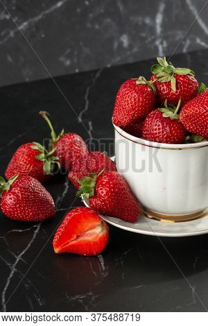 Fresh Strawberries In A White Cup On Marble Black Table. Fresh Nice Strawberries. Strawberry Field O