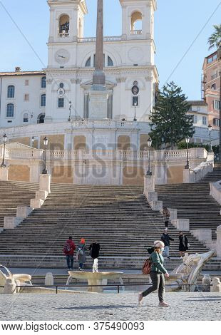 A Woman Wearing A Face Mask Walks In Front Of The Spanish Steps, Rome, Italy