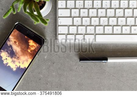 Modern Office Desk From Top View With Keyboard Phone And Pen
