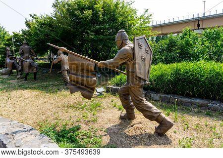Gimhae, South Korea - June 18, 2017 : Replica Of Gaya Dynasty Flag Bearer Bronze Statue In Gimehae,