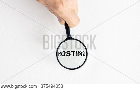 Computer Hosting And Internet Services Provider Concept With Word Hosting On Wooden Block