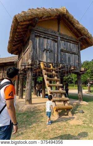 Gimhae, South Korea - June 18, 2017 : Tourists Look At Replica Of Traditional Korean Wooden House Of
