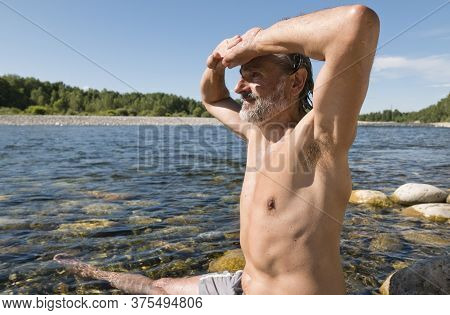 Man Bathing In The Clear Waters Of Sesia River, Piedmont, Italy