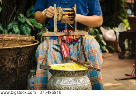 Bangkok, Thailand - 30 Mar 2016: A Man Weaves Silk Threads To Make Fabric From Boiled Mulberry Silkw