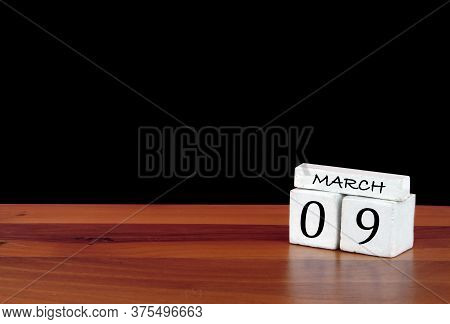 9 March Calendar Month. 9 Days Of The Month. Reflected Calendar On Wooden Floor With Black Backgroun