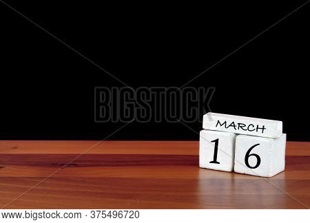 16 March Calendar Month. 16 Days Of The Month. Reflected Calendar On Wooden Floor With Black Backgro