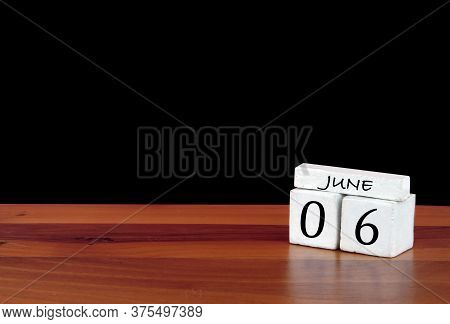 6 June Calendar Month. 6 Days Of The Month. Reflected Calendar On Wooden Floor With Black Background