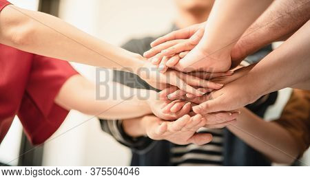 Stack Of Hand From Volunteering Of People To Show  Teamwork Spirit Togetherness, Concept Of Young Ge