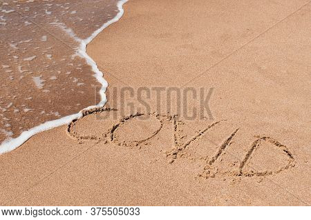 Covid Free, Stop Covid, Safe Beach And Holiday, Word Written On The Sand With Wave Washing And Clean