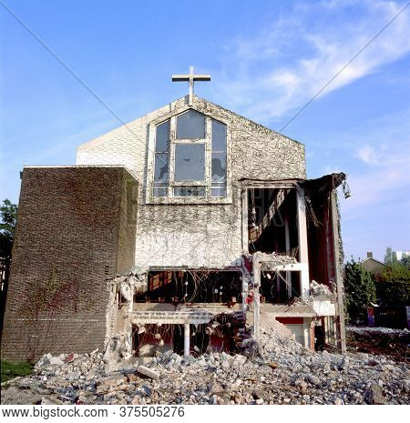 Church Being Demolished. Part Of The Interior Is Visible. Lots Of Rubble In Front.