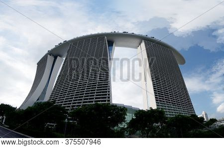 Singapore - 3 Jan 2015: The Iconic Marina Bay Sands Resort Is Seen From Below. The Modern Luxury Hot