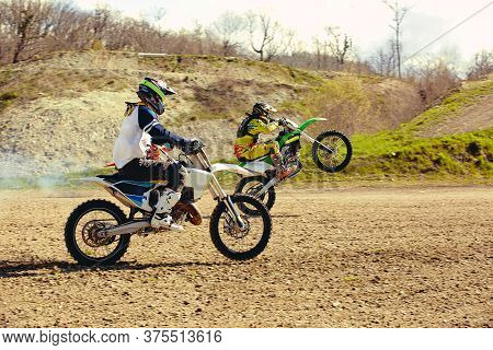 Motocross Bike Race Speed And Power In Extreme Man Sport , Sport Action Concept